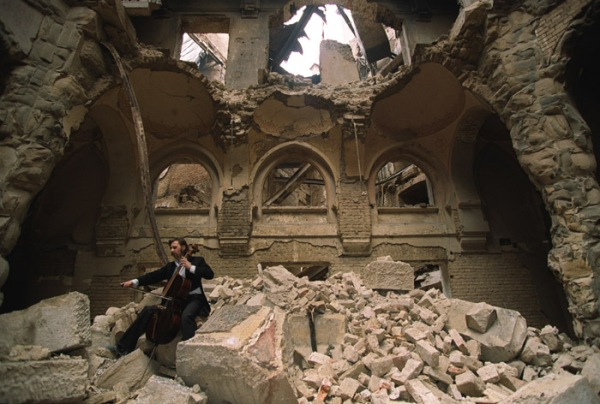Genocide, Endurance, Compassion, and Beauty: Vedran Smajlovic Playing his Cello in the Partial Ruins of the National Library